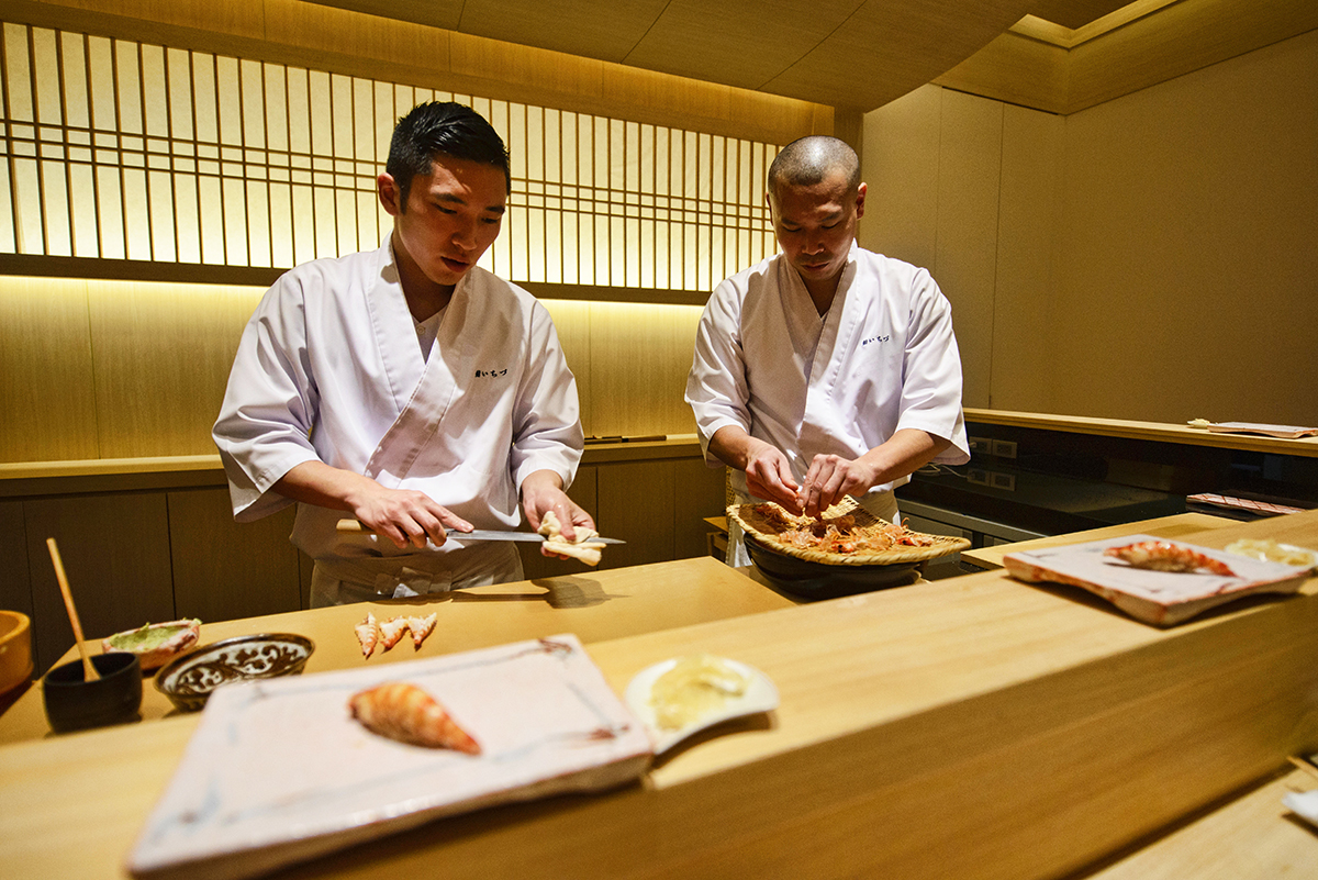 Chef preparing Ebi shrimp sushi at an omakase sushi restaurant