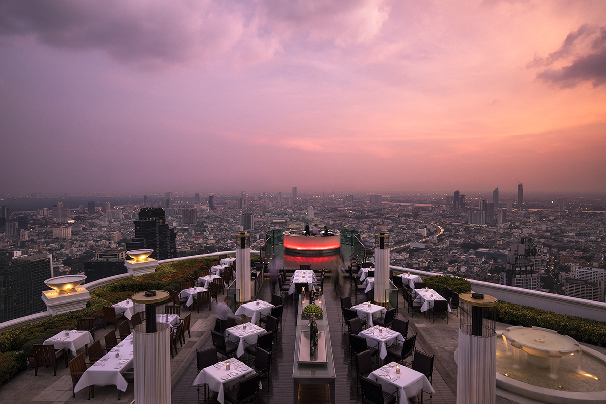 A rooftop bar in Bangkok at sunset