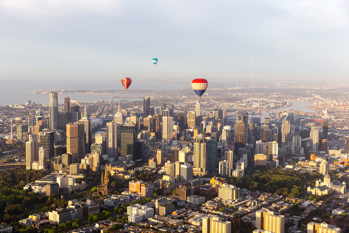 Hot air balloons flying directly past Melbourne Australia
