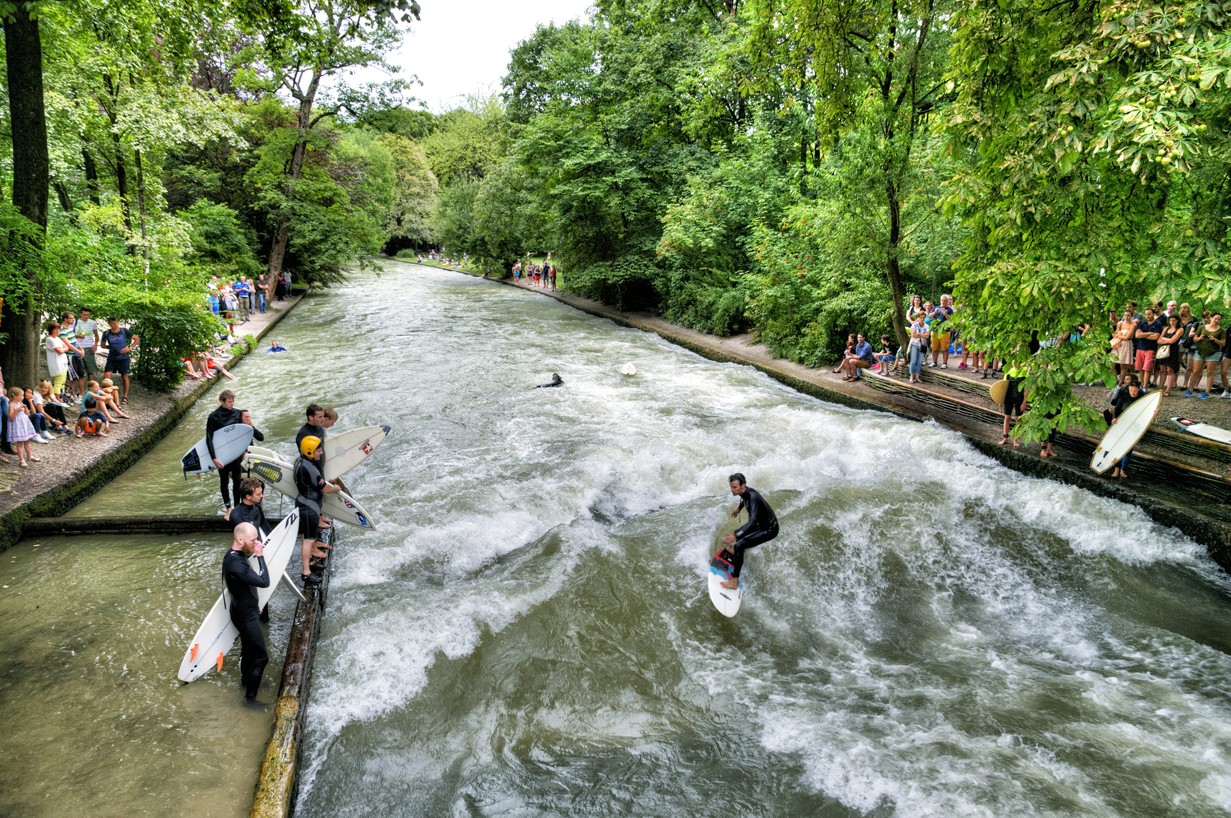 Surfing the Eisbach Munich Germany
