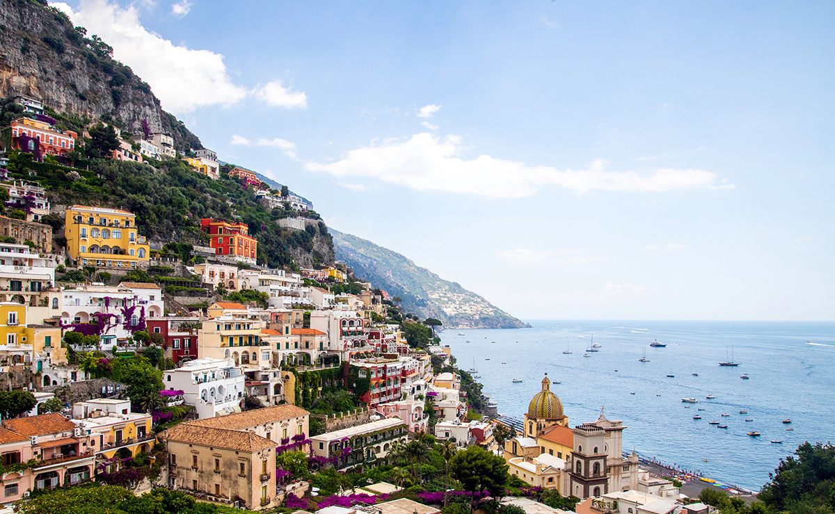 Colourful Positano houses against a sea backdrop