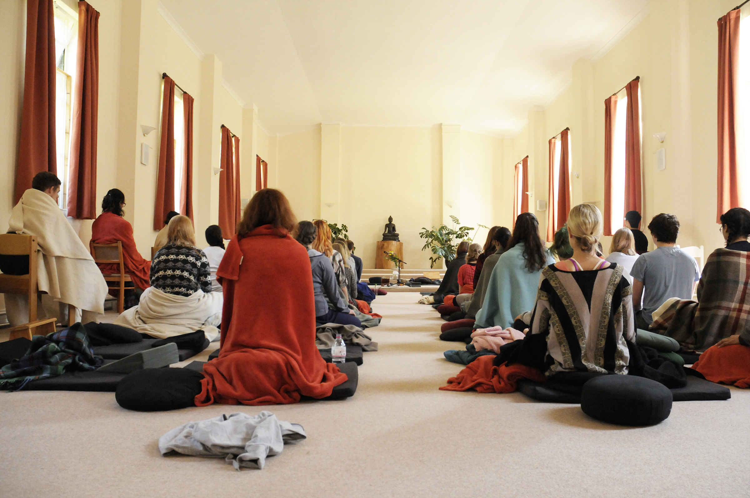 Room with people meditating
