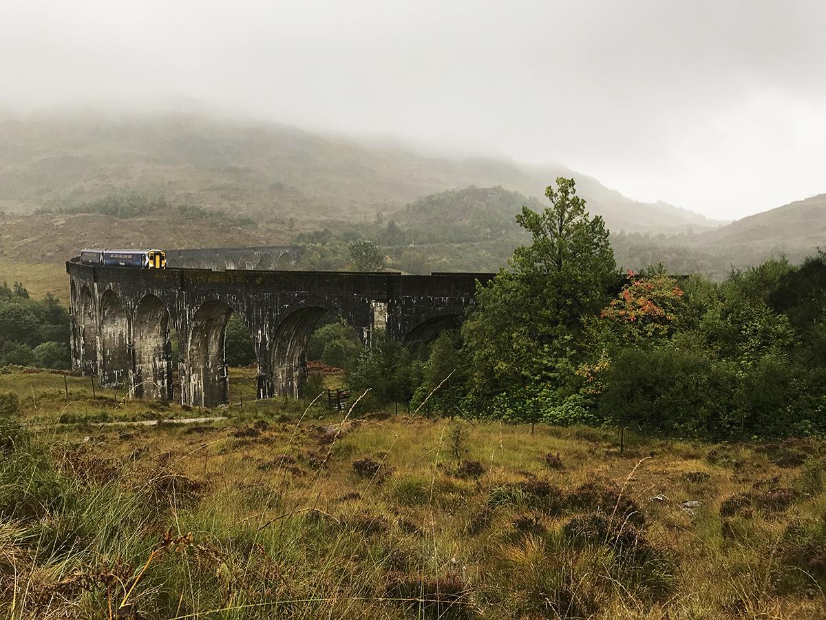 Scotrail train crossing Glenfinnan viaduct