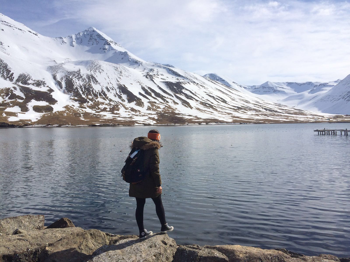 Girl standing by a lake in Iceland